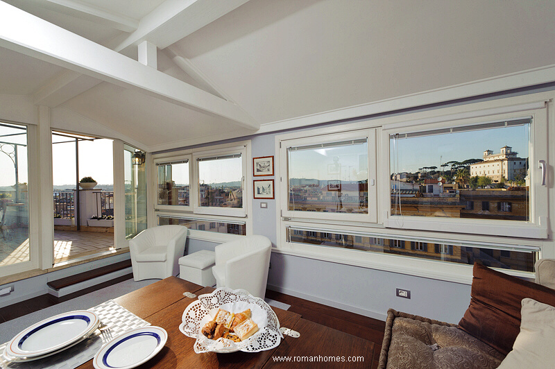 Sitting-dining room of the Spanish Steps Rome Seagulls penthouse with panoramic views